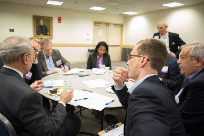 The 2014 Innovation Competition's judging panel during deliberation